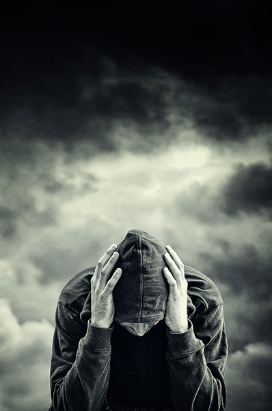 a man struggling with withdrawal symptoms