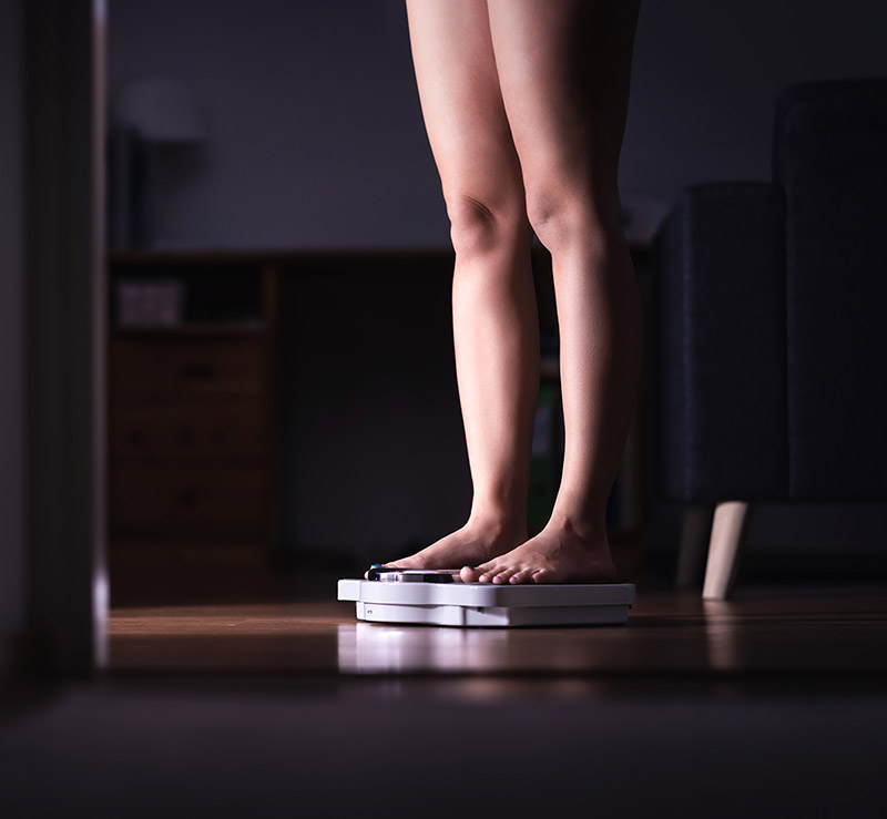 woman on a weighing scale